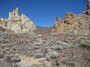 Lava rock could be seen around the formations.