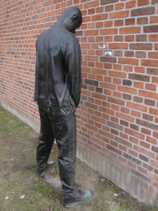 This statue was peeing against the wall.