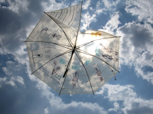 The square had floating umbrellas in the sky.