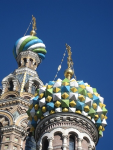 Detail of the richly decorated façade and onion domes.