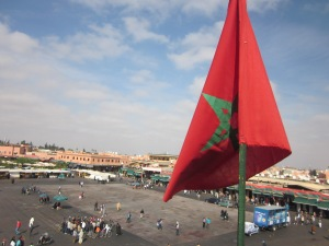 The Jemaa el-Fnaa square with the Moroccan flag.