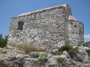 A small chapel at the top of a hill.