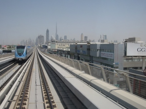 The metro with the Burj Khalifa tower in the background.